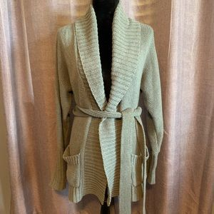 Express long tie over cardigan